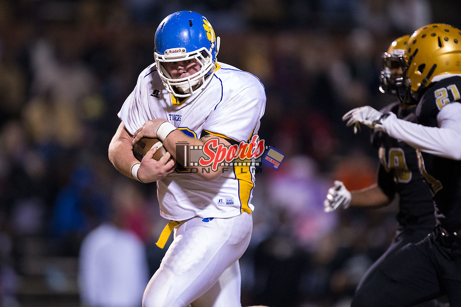 Zach Mayo (89) of the Mount Pleasant Tigers covers the ball with two hands after catching a pass during second half action against the Shelby Golden Lions at George Blanton Memorial Stadium November 27, 2015, in Shelby, North Carolina.  The Golden Lions defeated the Tigers 38-27.  (Brian Westerholt/Sports On Film)