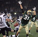 Jesuit senior defensive lineman David Tabata nearly blocks Lake Oswego's Will Storey's punt in the second half in the semifinals at PGE Park November 28, 2008.