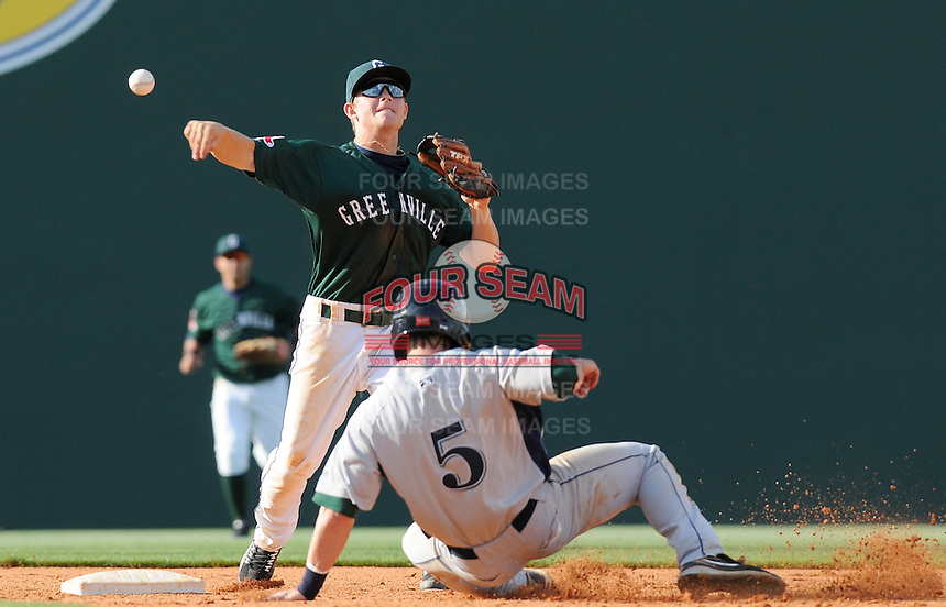 Grant Hogue (5) of the Lexington Legends is out at second as Greenville Drive second baseman Zach Gentile turns the double play in a game on April 25, 2010, at Fluor Field at the West End in Greenville, S.C. Photo by: Tom Priddy/Four Seam Images