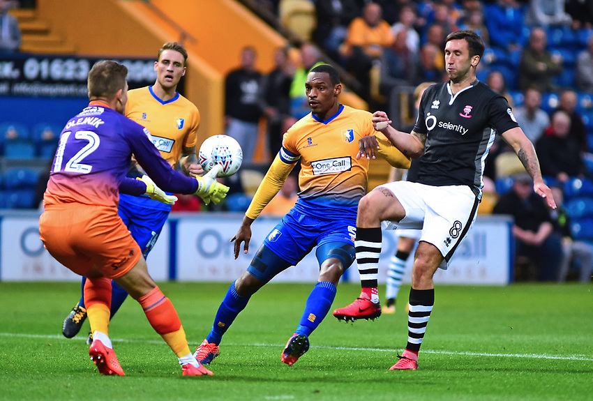 Lincoln City's Ollie Palmer vies for possession with Mansfield Town's Robert Olejnik andKrystian Pearce<br /> <br /> Photographer Andrew Vaughan/CameraSport<br /> <br /> The EFL Checkatrade Trophy - Mansfield Town v Lincoln City - Tuesday 29th August 2017 - Field Mill - Mansfield<br />  <br /> World Copyright &copy; 2018 CameraSport. All rights reserved. 43 Linden Ave. Countesthorpe. Leicester. England. LE8 5PG - Tel: +44 (0) 116 277 4147 - admin@camerasport.com - www.camerasport.com