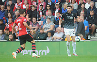 Burnley's Stephen Ward under pressure from Southampton's Cedric Soares<br /> <br /> Photographer Kevin Barnes/CameraSport<br /> <br /> The Premier League - Southampton v Burnley - Sunday August 12th 2018 - St Mary's Stadium - Southampton<br /> <br /> World Copyright &copy; 2018 CameraSport. All rights reserved. 43 Linden Ave. Countesthorpe. Leicester. England. LE8 5PG - Tel: +44 (0) 116 277 4147 - admin@camerasport.com - www.camerasport.com