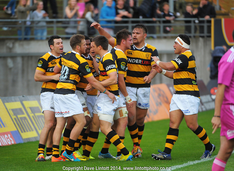 Waisake Naholo is congratulated by Taranaki teammates for his extra-time try during the ITM Cup rugby match between Taranaki and Auckland at Yarrow Stadium, New Plymouth, New Zealand on Saturday, 18 October 2014. Photo: Dave Lintott / lintottphoto.co.nz