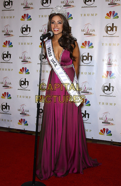 Olivia Culpo.press conference to introduce the 2012 Miss USA (formerly Miss Rhode Island) at Planet Hollywood Resort and Casino, Las Vegas, Nevada, USA..3rd June 2012.full length pink dress crown sash microphone cleavage .CAP/ADM/MJT.© MJT/AdMedia/Capital Pictures.