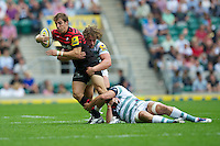 Chris Wyles of Saracens is tackled by Max Lahiff of London Irish during the Aviva Premiership match between Saracens and London Irish at Twickenham on Saturday 1st September 2012 (Photo by Rob Munro)
