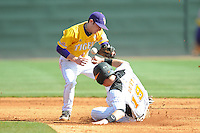 Tyler Hanover #11 of the LSU Tigers attempts to apply a tag to the sliding Matt Duffy #19 of the Tennessee Volunteers as the ball comes loose at Lindsey Nelson Stadium in game against Tennessee Volunteers in Knoxville, TN March 27, 2010 (Photo by Tony Farlow/Four Seam Images)