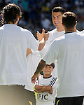 Zaid Abdul, Syrian refugee boy on the court at Santiago Bernabeu Stadium with Cristiano Ronaldo before Real Madrid vs Granada, La Liga match. September 19,2015. (ALTERPHOTOS/Acero)