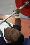 Austalia's Abebe Fekadu shows fierce determination in a pre games training session prior to competition in the men's under 56kg powerlifting event. His first Paralympic competition saw him finish a credible 10th place, with a lift of 155kg, but not lifting to his best on the day.