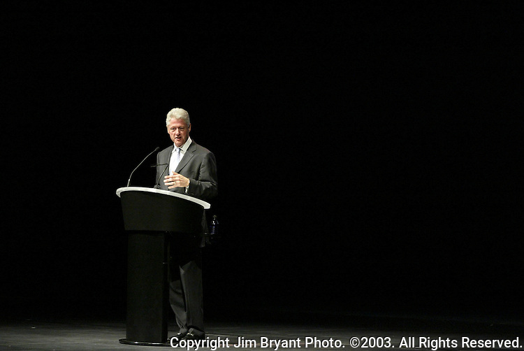 Former President Bill Clinton speaks to an audience at McCaw Hall on Tuesday, Sept., 16, 2003 in Seattle, Wash. Clinton was in town attending a fund raising event for arts and entertainment for young people. Jim Bryant Photo. ©2003. All Rights Reserved.