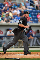 Umpire James Rackley gets in position during the second game of a double header between the Biloxi Shuckers and Pensacola Blue Wahoos on April 26, 2015 at Pensacola Bayfront Stadium in Pensacola, Florida.  Pensacola defeated Biloxi 2-1.  (Mike Janes/Four Seam Images)