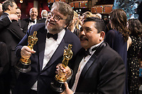 Oscar winner Guillermo del Toro poses with guests following the live ABC Telecast of The 90th Oscars&reg; at the Dolby&reg; Theatre in Hollywood, CA on Sunday, March 4, 2018.<br /> *Editorial Use Only*<br /> CAP/PLF/AMPAS<br /> Supplied by Capital Pictures