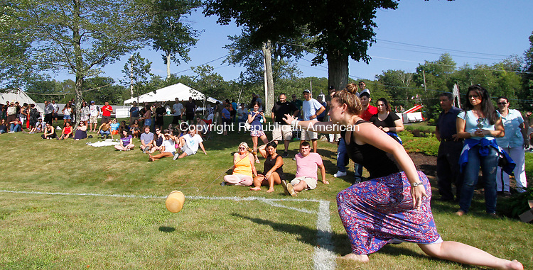 WATERBURY, CT - 08 AUGUST 2017 - 080517JW05.jpg -- Caterina Perugini of Watertown attempts her second ever rolling of the cheese during the Festa di San Donato Saturday evening at the Pontelandolfo Community Club.  Jonathan Wilcox Republican-American