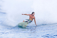 Three times world professional surfing champion ANDY IRONS (HAWAII)  surfing at TEAHUPOO, Tahiti . Photo: joliphotos