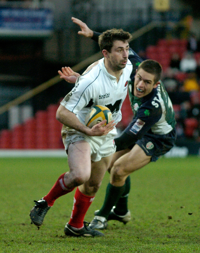 Photo: Richard Lane..Saracens v London Irish. Powergen Cup. 23/01/2005..Kevin Sorrell breaks past Scott Staniforth.