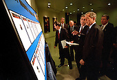 United States President George W. Bush reviews the list of the Most Wanted Terrorists with FBI Director Robert Mueller, left, during a visit to the bureau's headquarters in Washington, DC, October 10, 2001 to announce the creation of the list.  Attorney General John Ashcroft looks on from the far right.<br /> Mandatory Credit: Eric Draper - White House via CNP