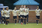 Sam Raben (26) of the Wake Forest Demon Deacons leads his team on to the field prior to the match against the North Carolina State Wolfpack at W. Dennie Spry Soccer Stadium on September 7, 2018 in Winston-Salem, North Carolina.  The Demon Deacons defeated the Wolfpack 3-0 in double-overtime.  (Brian Westerholt/Sports On Film)