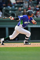 Shortstop Jeremy Rivera (35) of the Greenville Drive bats in a game against the Asheville Tourists on Sunday, April 10, 2016, at Fluor Field at the West End in Greenville, South Carolina. Greenville won 7-4. (Tom Priddy/Four Seam Images)