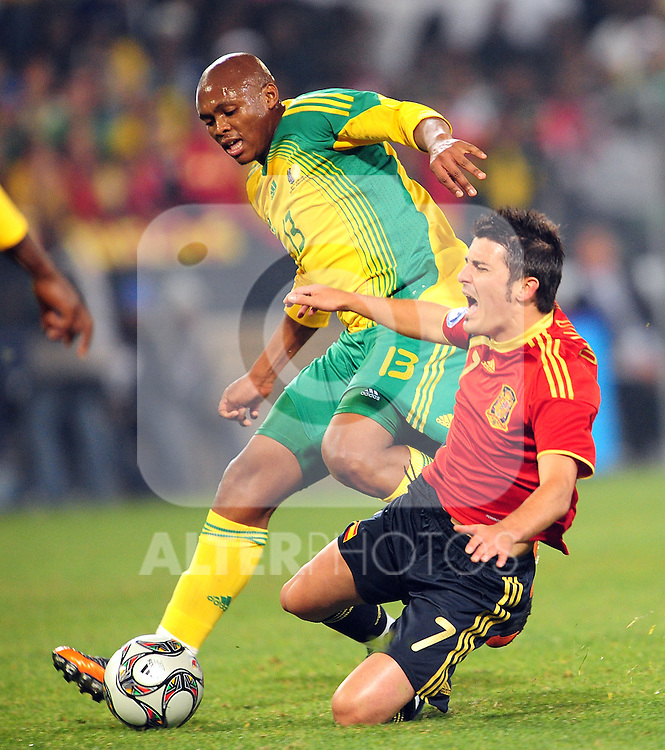Kagisho Dikgaloi and David Villa  during the soccer match of the 2009 Confederations Cup between Spain and South Africa played at the Freestate Stadium,Bloemfontein,South Africa on 20 June 2009.  Photo: Gerhard Steenkamp/Superimage Media.