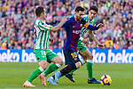 Lionel Andres Messi of FC Barcelona (C)  competes for the ball with Marc Bartra Aregall (R) and Jose Andres Guardado Hernandez of Real Betis during the La Liga 2018-19 match between FC Barcelona and Real Betis at Camp Nou, on November 11 2018 in Barcelona, Spain. Photo by Vicens Gimenez / Power Sport Images