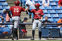 Altoona Curve first baseman Will Craig (25) fist bumps with Jordan George (24) on his way back to the dugout after hitting a home run in the top of the fourth inning during a game against the Binghamton Rumble Ponies on June 14, 2018 at NYSEG Stadium in Binghamton, New York.  Altoona defeated Binghamton 9-2.  (Mike Janes/Four Seam Images)