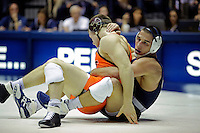 STATE COLLEGE, PA -DECEMBER 19: Garett Hammond of the Penn State Nittany Lions wrestles Chris Moon of the Virginia Tech Hokies during their 165 pound bout on December 19, 2014 at Recreation Hall on the campus of Penn State University in State College, Pennsylvania. Penn State won 20-15. (Photo by Hunter Martin/Getty Images) *** Local Caption *** Chris Moon;Garett Hammond