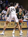 `SIOUX FALLS, SD: MARCH 20:  Isaiah Eisendorf #5 of Le Moyne looks over West Texas A&M defender Gaige Prim #24 during their game at the 2018 Division II Men's Elite 8 Basketball Championship at the Sanford Pentagon in Sioux Falls, S.D. (Photo by Dick Carlson/Inertia)