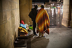 Some African migrants sheltered from the rain and cold under the arches of Irun City Council. Irun (Basque Country). Ocotber 29, 2018. A group of volunteers has created a host network to serve migrants and inform about the public services they are entitled to and the ways to cross the border. This group of volunteers is avoiding a serious humanitarian problem Irun, the Basque municipality on the border with Hendaye. As the number of migrants arriving on the coasts of southern Spain incresead, more and more migrants are heading north to the border city of Irun. French authorities have reacted by conducting random checks as far as the city of Bordeaux, more than 200 kilometers north of the border. Migrants who are caught are then deported back to Irun. (Gari Garaialde / Bostok Photo).
