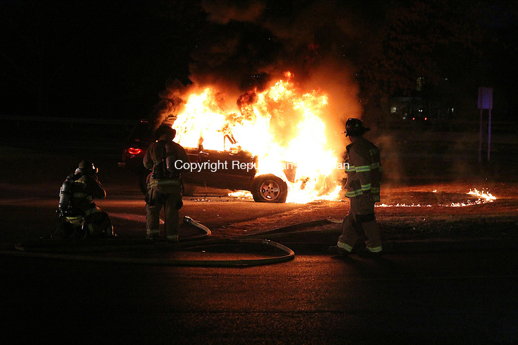 SOUTHBURY, CT: 10 Dec. 2015: 10122015CB01: SOUTHBURY -- Firefighters prepare to battle a vehicle blaze Thursday in Southbury at the Subway parking lot on Oak Tree Road near the intersection of Main Street South. Caleb Bedillion Republican-American