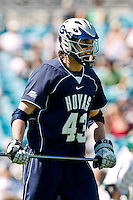 February 20, 2011:   Georgetown Hoyas defender Barney Ehrmann (43) during Lacrosse action between the Georgetown Hoyas and Jacksonville Dolphins during the Moe's Southwest SunShine Classic played at EverBank Field in Jacksonville, Florida.  Georgetown defeated Jacksonville 14-11.