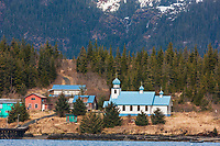 Chugach mountains flank a Russian orthodox church and village homes of the native community of Tatitlek in eastern Prince William Sound, southcentral, Alaska.