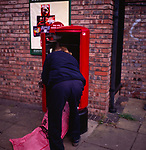 A294NF Postman emptying post box
