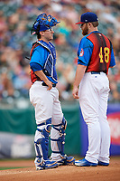 Buffalo Bisons catcher Danny Jansen (41) talks with starting pitcher Brett Anderson (48) during an injury delay during a game against the Gwinnett Braves on August 19, 2017 at Coca-Cola Field in Buffalo, New York.  The Bisons wore special Superhero jerseys for Superhero Night.  Gwinnett defeated Buffalo 1-0.  (Mike Janes/Four Seam Images)