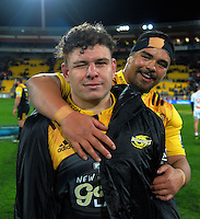 Ricky Riccitelli and Mike Kainga celebrate victory after the Super Rugby semifinal match between the Hurricanes and Chiefs at Westpac Stadium, Wellington, New Zealand on Saturday, 30 July 2016. Photo: Dave Lintott / lintottphoto.co.nz