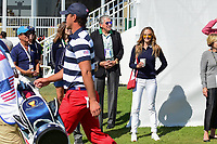 Brooks Koepka's (USA) girlfriend Jena Sims is all smiles as he walks by her departing the first tee during round 4 Singles of the 2017 President's Cup, Liberty National Golf Club, Jersey City, New Jersey, USA. 10/1/2017. <br /> Picture: Golffile | Ken Murray<br /> <br /> All photo usage must carry mandatory copyright credit (&copy; Golffile | Ken Murray)