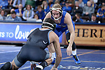 SIOUX FALLS, SD - NOVEMBER 15: Kahlen Morris from South Dakota State readies to grapple Audey Ashkar from Binghamton during their 125 pound match Friday night at the Sanford Pentagon in Sioux Falls, SD. (Photo by Dave Eggen/Inertia)