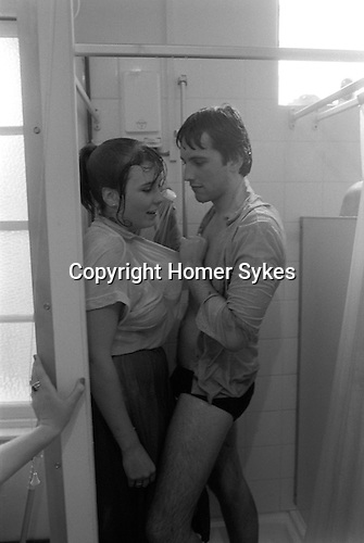 Students undergraduates at Corpus Christi college take a shower together at Cambridge University England. 1983