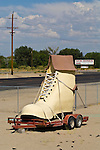 Giant shoe strapped to a trailer