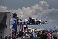 Apr. 28, 2013; Baytown, TX, USA: NHRA crew members load the car of pro stock driver Larry Morgan into the hauler during the Spring Nationals at Royal Purple Raceway. Mandatory Credit: Mark J. Rebilas-