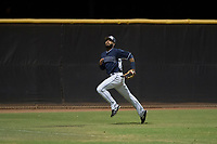 AZL Padres 2 left fielder Luis Roman (4) pursues a fly ball during an Arizona League game against the AZL Padres 1 at Peoria Sports Complex on July 14, 2018 in Peoria, Arizona. The AZL Padres 1 defeated the AZL Padres 2 4-0. (Zachary Lucy/Four Seam Images)