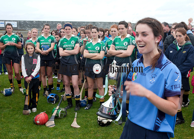 071012.Dejected Scariff Ogonnelloe players look on as Truagh Captain Helen Guinnane makes her speech after victory in the Intermediate Final at Clarecastle on Sunday.