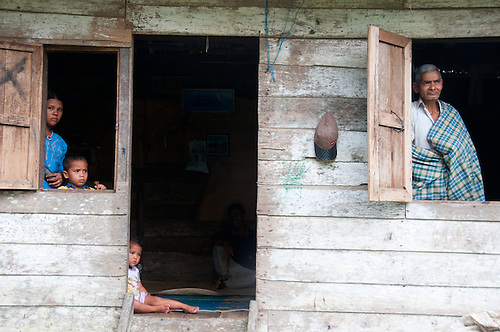 Indonesia, Sumatra, Aceh. Poor Indonesian family in traditional housing.