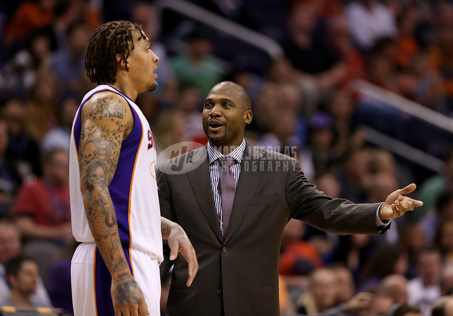 Jan. 24, 2013; Phoenix, AZ, USA: Phoenix Suns interim head coach Lindsey Hunter with forward Michael Beasley against the Los Angeles Clippers at the US Airways Center. The Suns defeated the Clippers 93-88. Mandatory Credit: Mark J. Rebilas-USA TODAY Sports