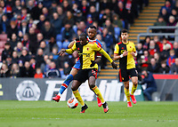 7th March 2020; Selhurst Park, London, England; English Premier League Football, Crystal Palace versus Watford; Abdoulaye Doucoure of Watford being challenged by Jordan Ayew of Crystal Palace