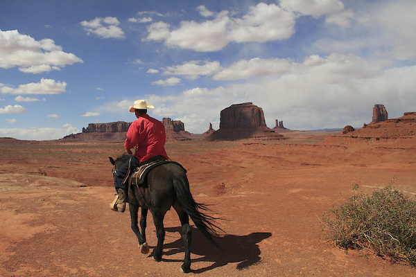 Navajo Indian on black horse at John Ford Overlook, Monument Valley, Arizona, USA. . John offers private photo tours in Monument Valley and throughout Arizona, Utah and Colorado. Year-round.
