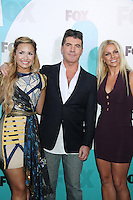 Demi Lovato, Simon Cowell and Britney Spears at the Fox 2012 Programming Presentation Post-Show Party at Wollman Rink in Central Park on May 14, 2012 in New York City.