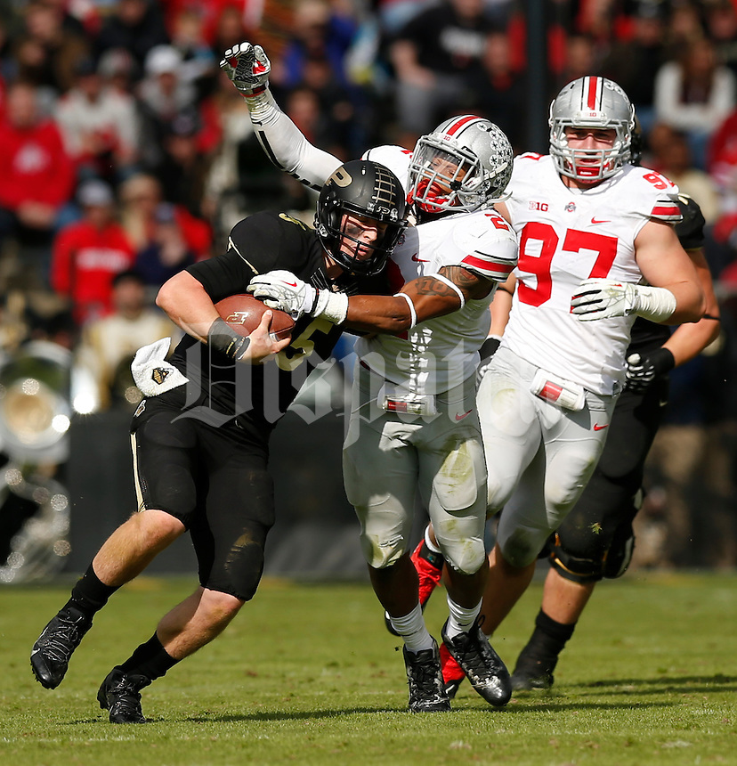 Purdue Boilermakers quarterback Danny Etling (5) is tackled by Ohio State Buckeyes linebacker Ryan Shazier (2) during Saturday's NCAA Division I football game at Ross-Ade Stadium in West Lafayette, In. on November 2, 2013. (Barbara J. Perenic/The Columbus Dispatch)