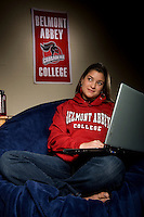 A college students uses a laptop in her dorm room in Belmont, NC.