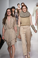 Senior fashion designer Megan Jones, walks runway with model, at the close of the Pratt 2011 fashion show.