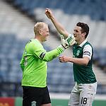 Hibs keeper Conrad Logan celebrates with John McGinn