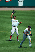 Pawtucket Red Sox outfielder Carlos Peguero (45) catches a fly ball as Jeff Bianchi (16) gets out of the way during a game against the Rochester Red Wings on July 1, 2015 at Frontier Field in Rochester, New York.  Rochester defeated Pawtucket 8-4.  (Mike Janes/Four Seam Images)