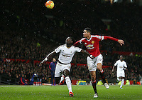 Bafetibis Gomis of Swansea City and Chris Smalling of Manchester United during the Barclays Premier League match between Manchester United and Swansea City played at Old Trafford, Manchester on January 2nd 2016